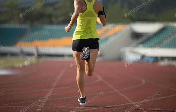 RunningSportswoman running on stadium