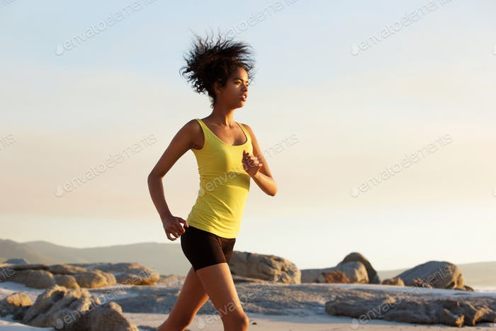 Young african american woman speed walking outdoors