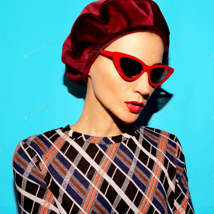 Model in a fashion accessory beret and sunglasses. Vintage tren