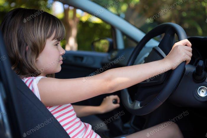 Teenage girl driving a car