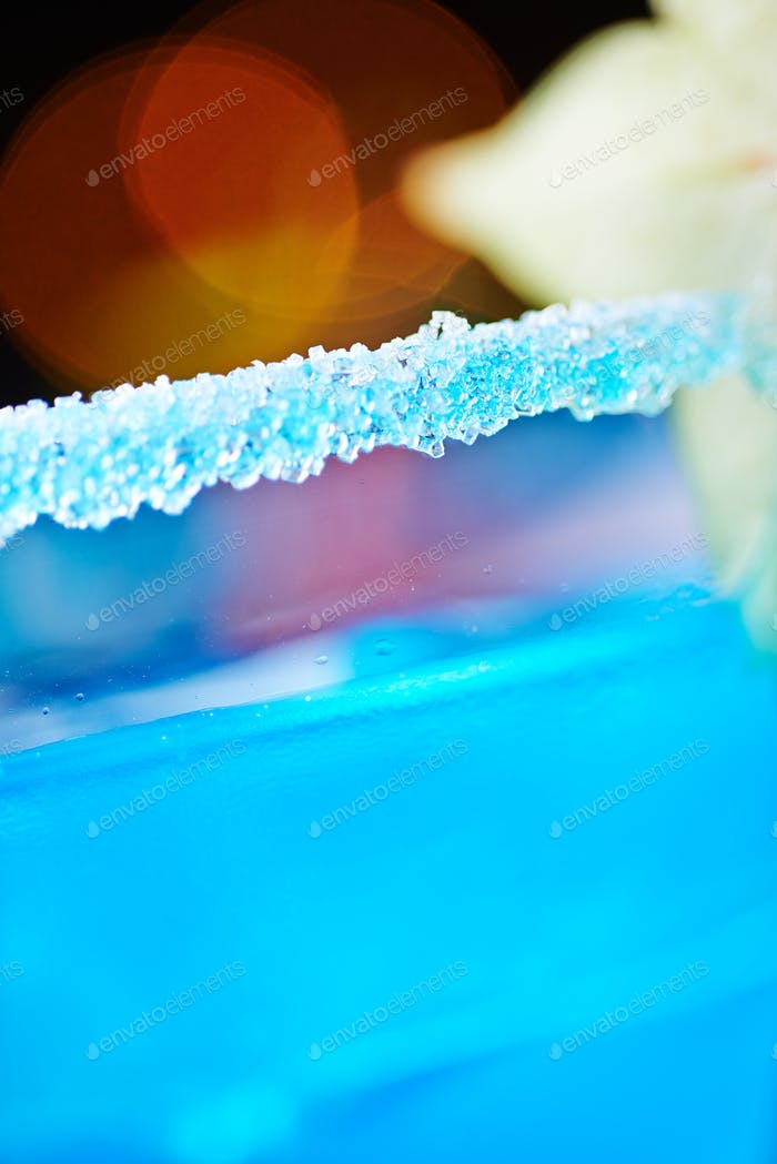 extremely close up of bright refreshing cocktails: blue margarita