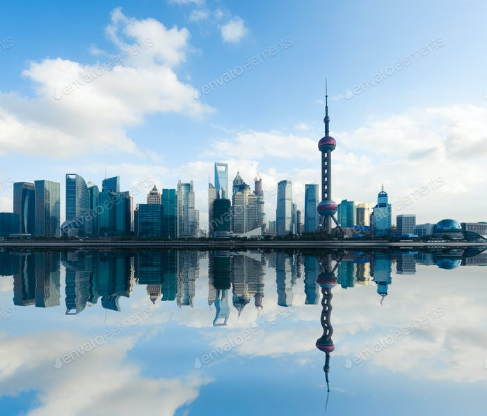 shanghai skyline with reflection at daytime