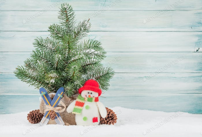 Christmas greeting card with tree and xmas decor