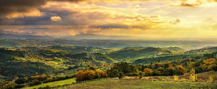 Maremma sunset panorama. Countryside, hills and sea on horizon.