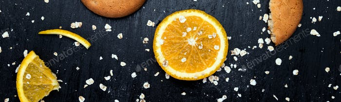 Banner of Oatmeal cookies and orange citrus fruit background. Flat lay