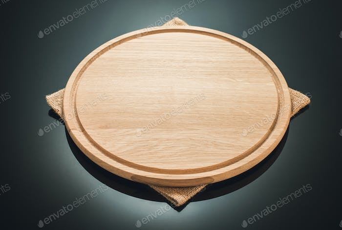 pizza cutting board at black background