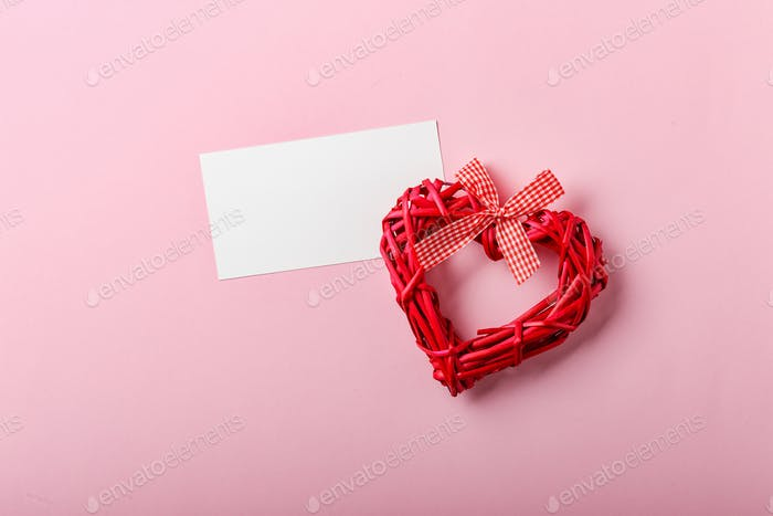 Decorative hearts on pink background. Place for text.