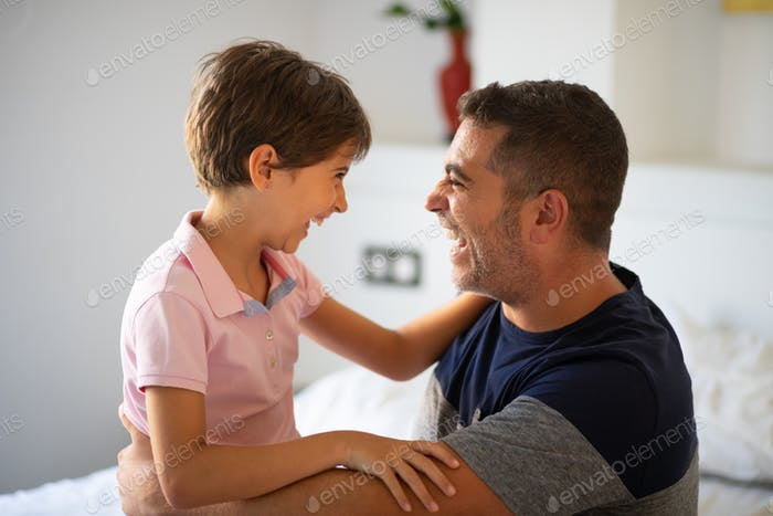 Middle-age man and her little daughter are hugging
