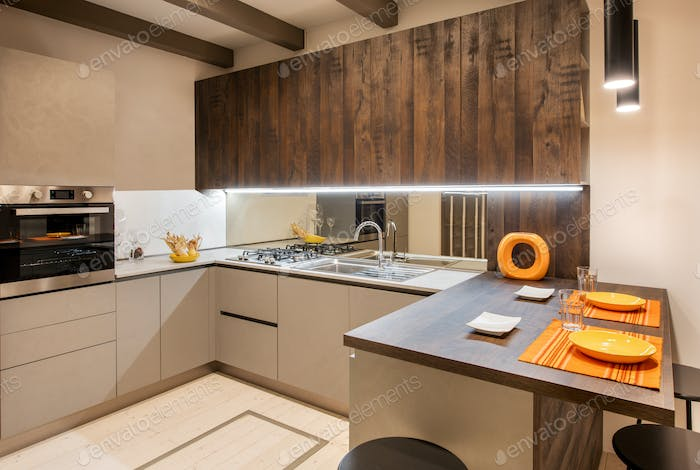 Interior of modern f kitchen with orange accents