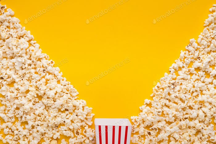 Popcorn on yellow background, top view