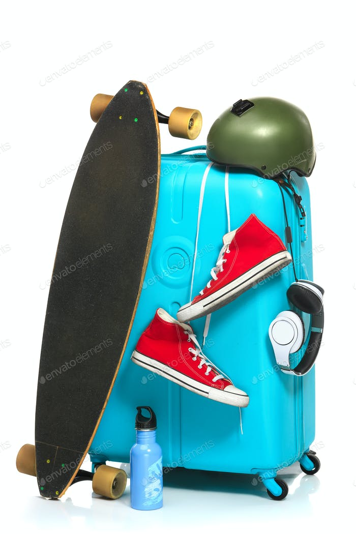 Thumbnail for The blue suitcase, sneakers, skateboard on white background.