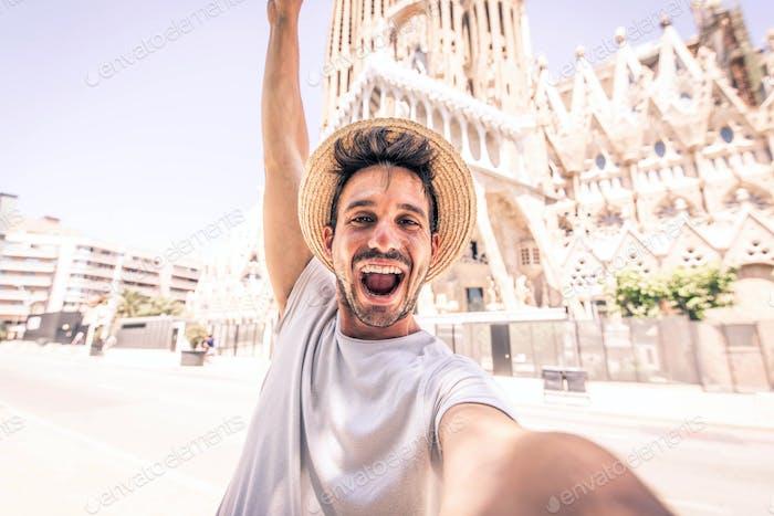 Happy tourist visiting La Sagrada Familia, Barcelona Spain