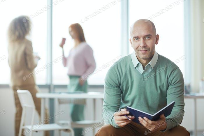 Smiling Mature Man in Office Interior
