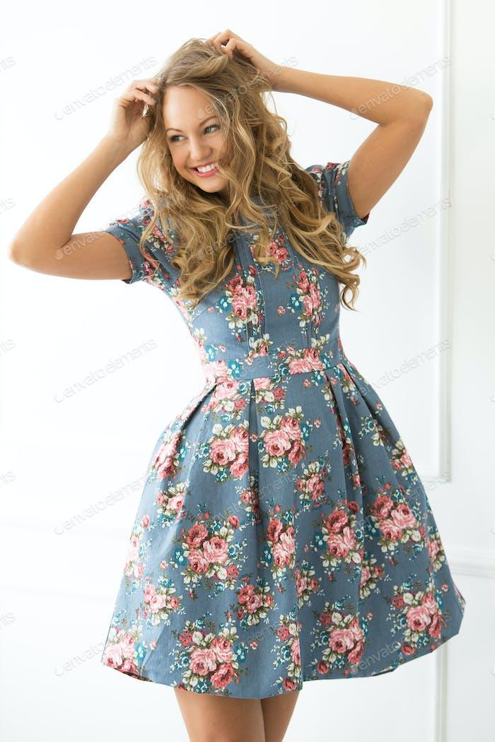 Curly girl in beautiful dress