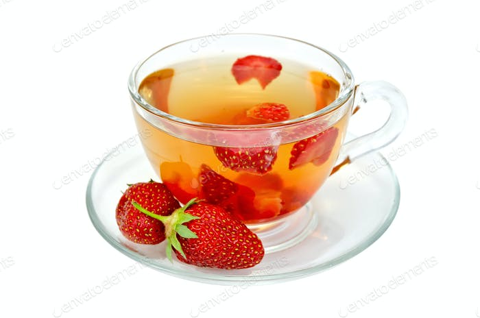 Tea with strawberries in a glass cup