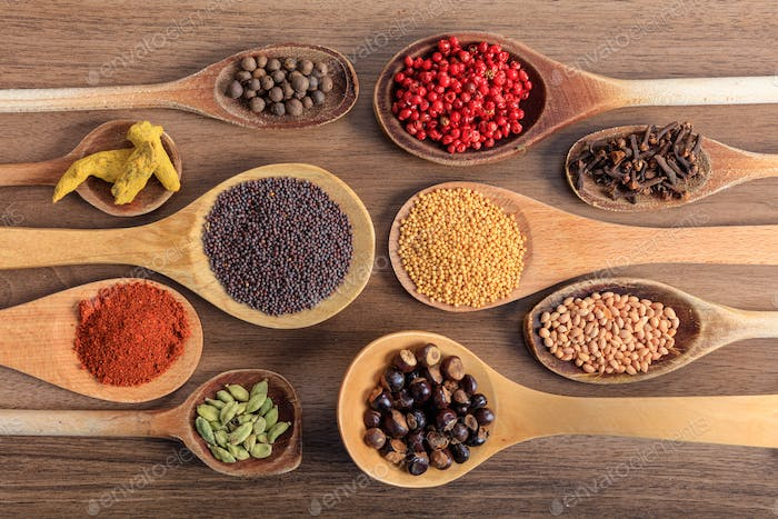Variety of spices on a wooden surface
