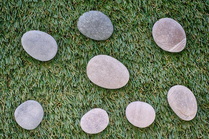 Bunch of stones lying on green grass