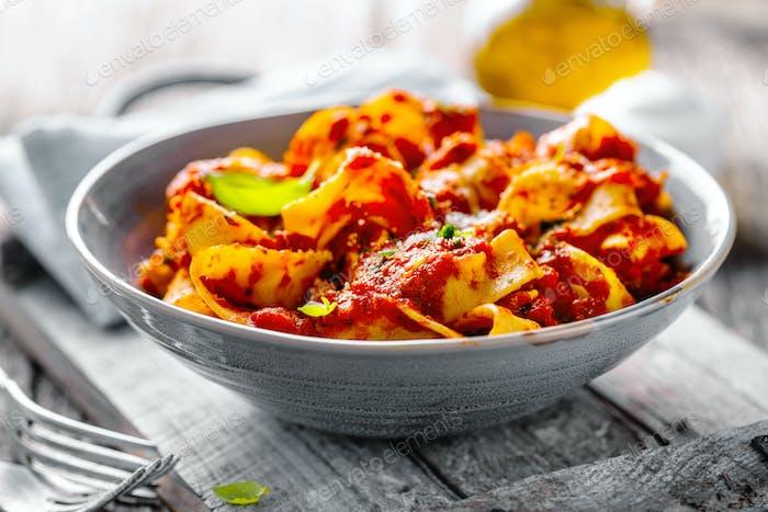 Italian spaghetti with tomato sauce served on plate