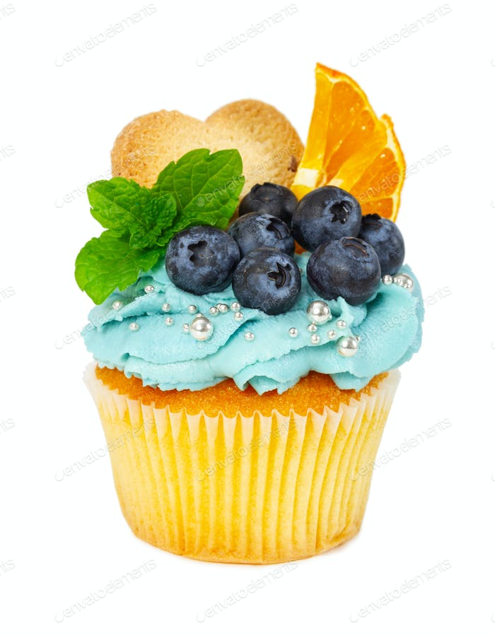 Cupcake with cookies, fresh blueberries, mint and slices of oran