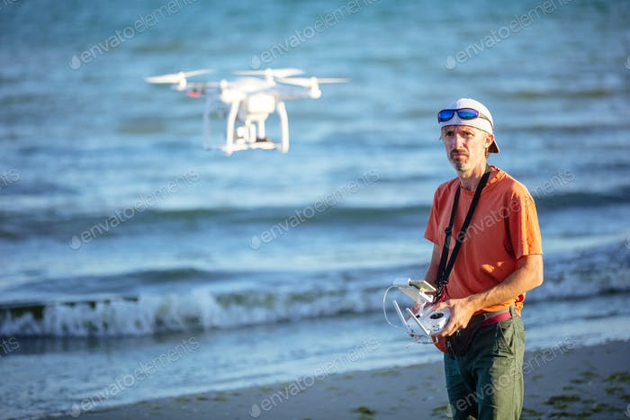 Man operating drone with remote control