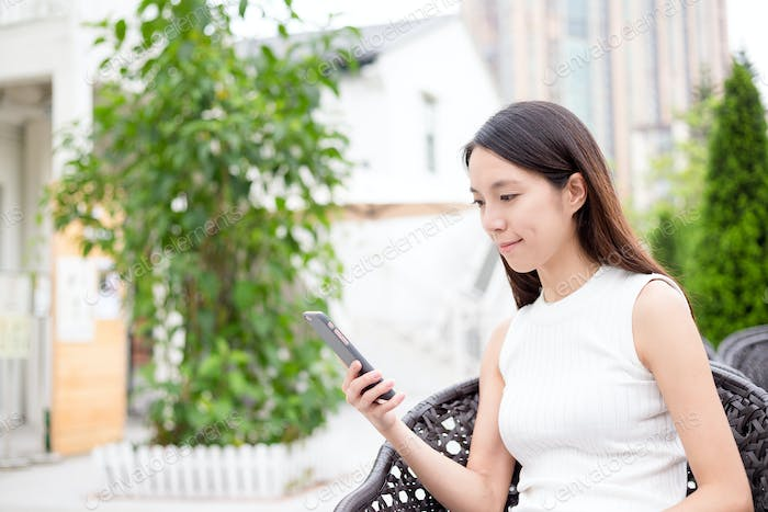 Young Woman browsing internet on phone