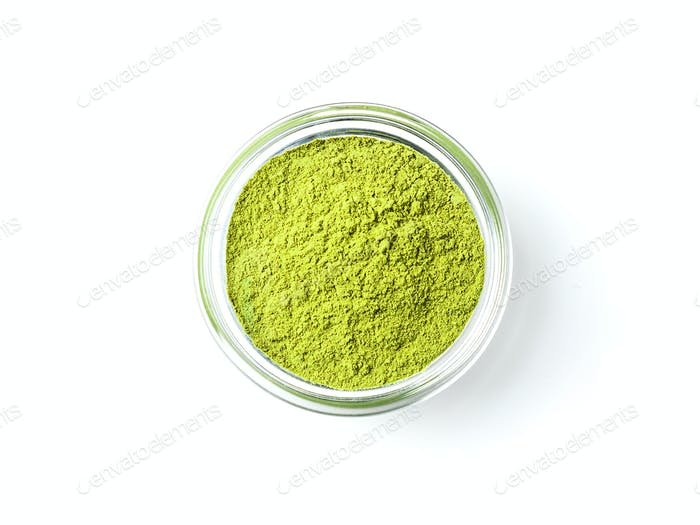 Green matcha tea powder, white background