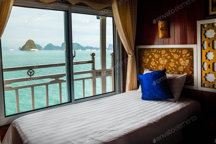 Bed in cruise ship cabin. Halong Bay, Vietnam