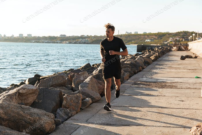 Portrait of a fit sportsman jogging