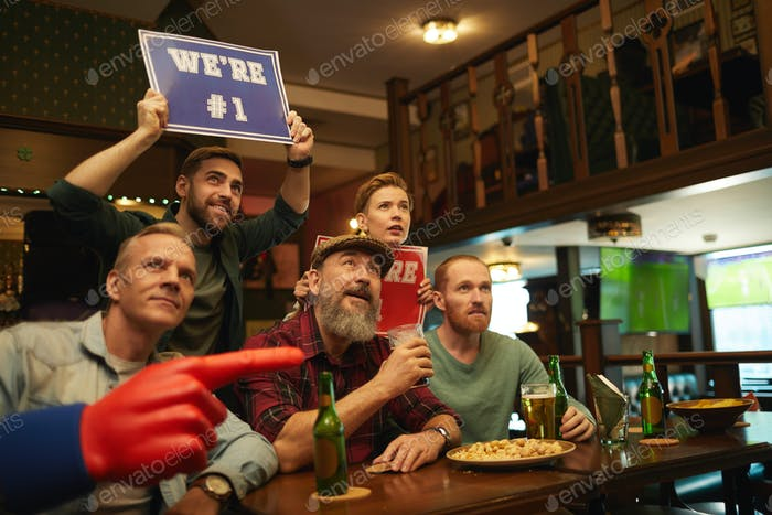 Group of football fans in the bar