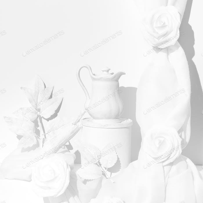 Fashion winter scene. Tea pot, roses and textile decor. Minimal stylish white cold colours design