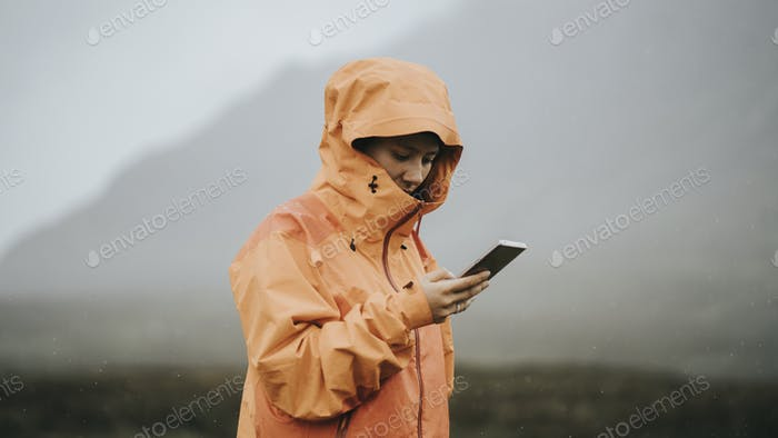 Orange raincoat in the rain
