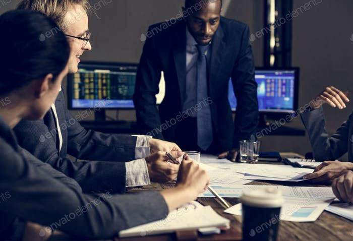 Group of entrepreneur analysing for investment in meeting room