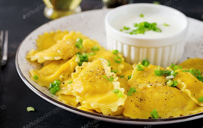 Ravioli with spinach and ricotta cheese. Italian cuisine.