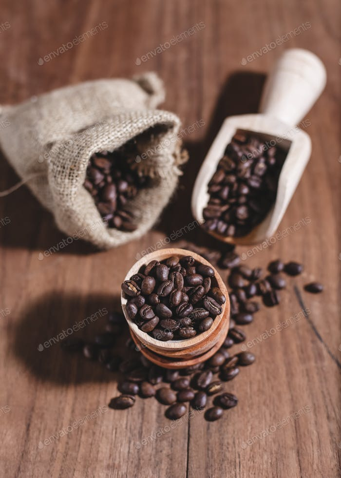 coffee beans coffee bag and wooden scoop