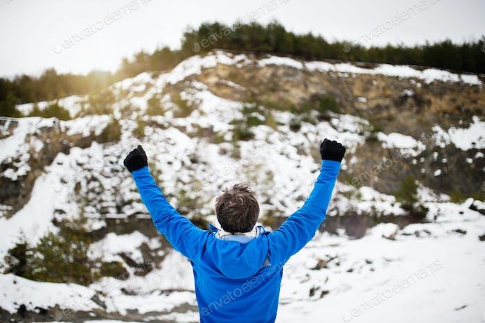 Senior man jogging in winter nature.