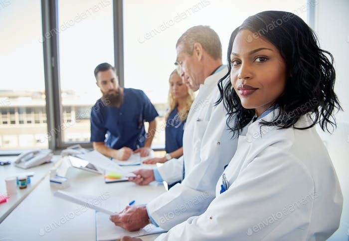 Female doctor looking at camera in clinic