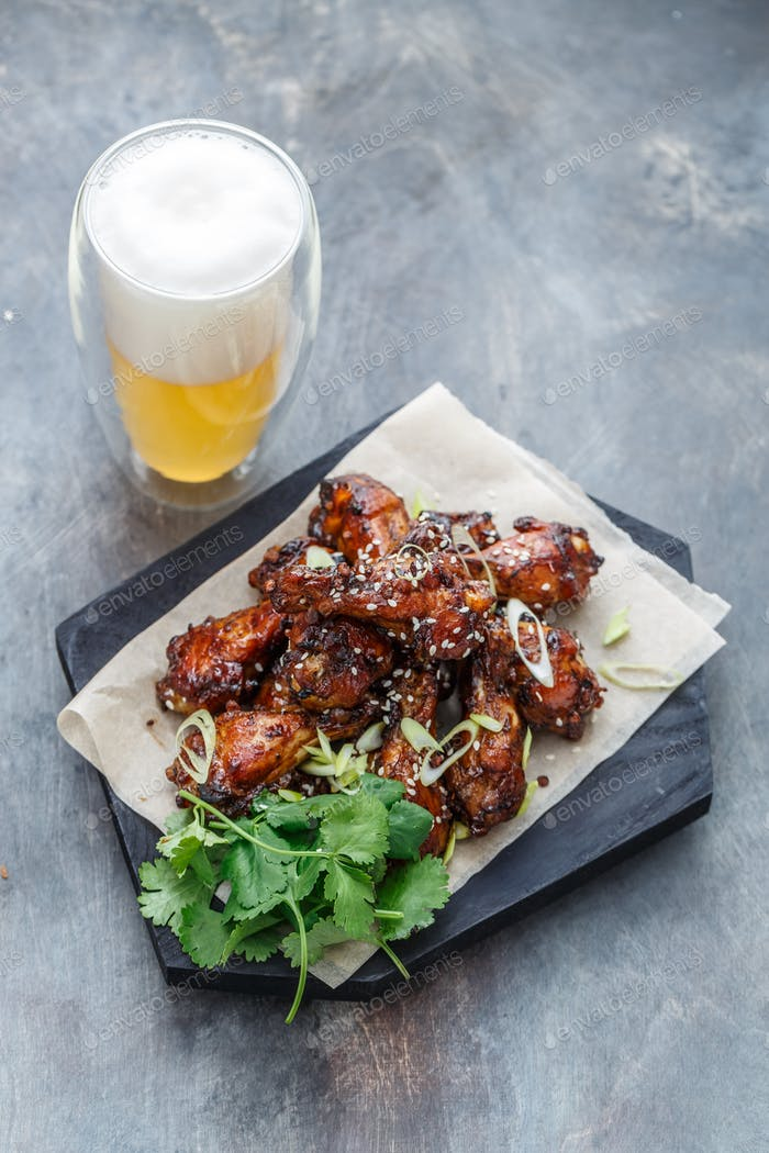 Asian chicken wings bbq with beer and coriander, copy space