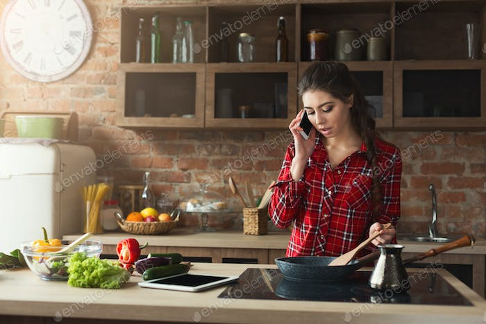 Woman preparing healthy food in the home kitchen