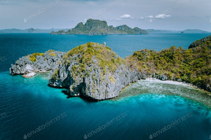 Aerial drone panorama picture of tropical paradise epic limestone Entalula Island. Miniloc island in