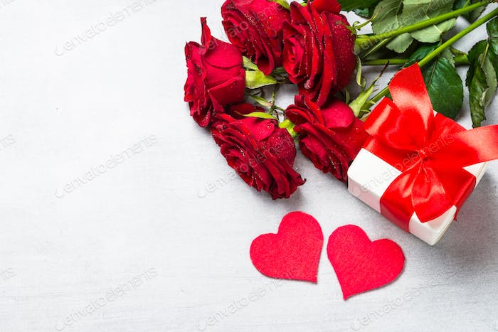 Valentines day background with present and flower.