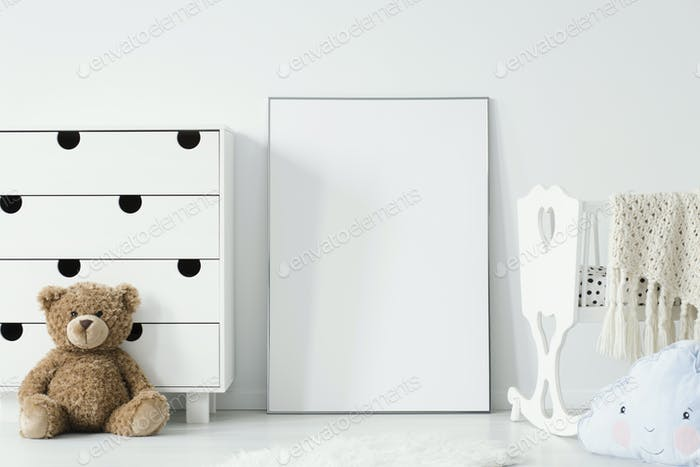 Mockup of white empty poster between cradle and teddy bear in ki