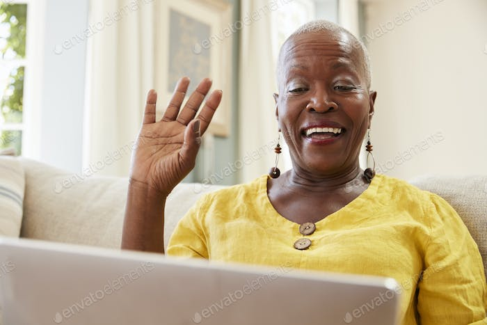 Senior Woman Using Laptop To Connect With Family For Video Call