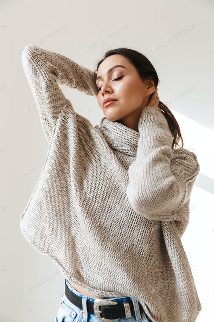 Image of relaxed asian woman posing with eyes closed