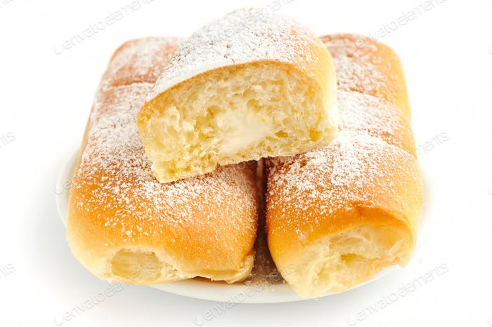 Italian buns with sweet cream on white background