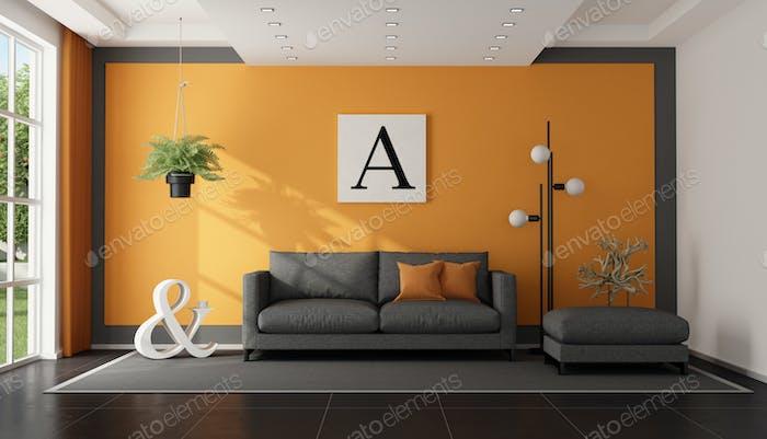 Modernes graues und orangefarbenes Wohnzimmer mit Stoffsofa und Hocker - 3D Rendering
