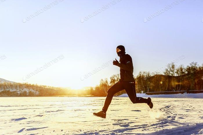 athlete runner running on snow