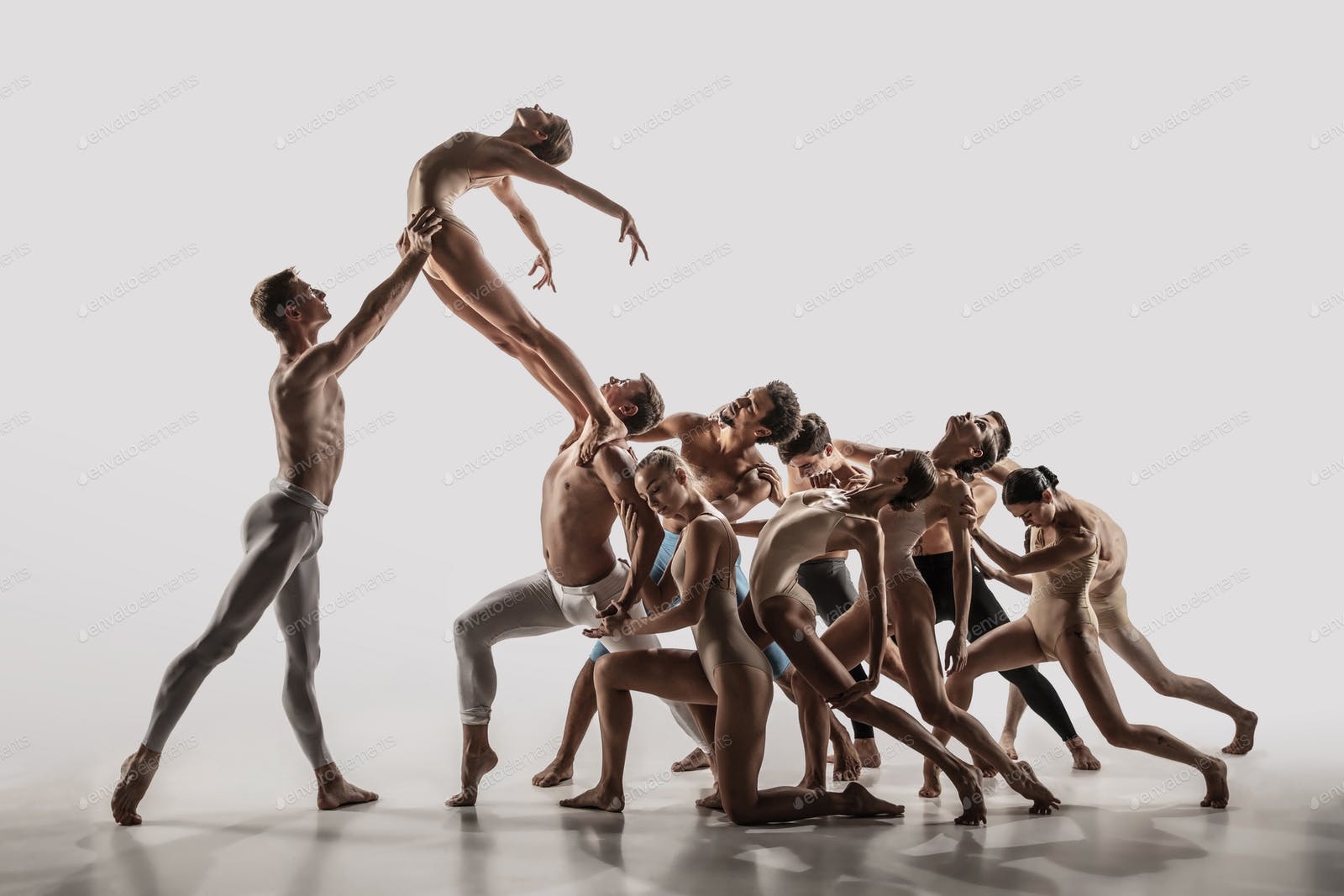 The group of modern ballet dancers. Contemporary art ballet. Young flexible  athletic men and women photo by master1305 on Envato Elements