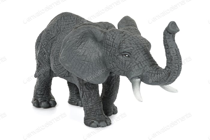 Elephant toy figure on white background
