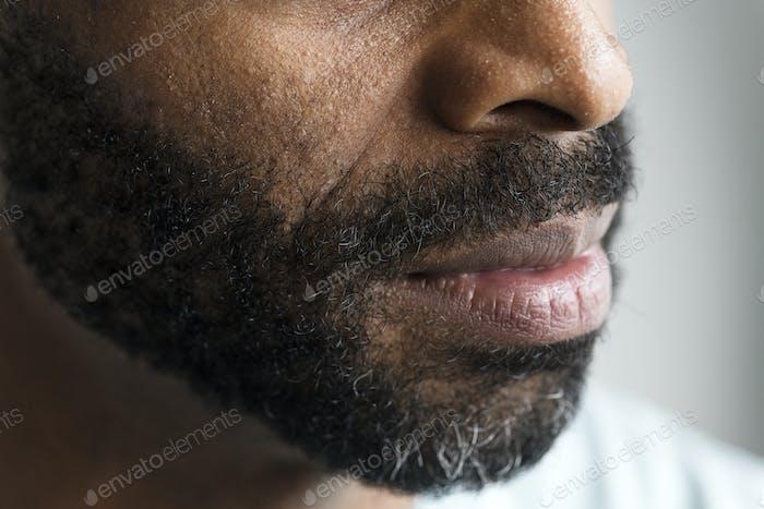 Closeup of a mouth of a black man