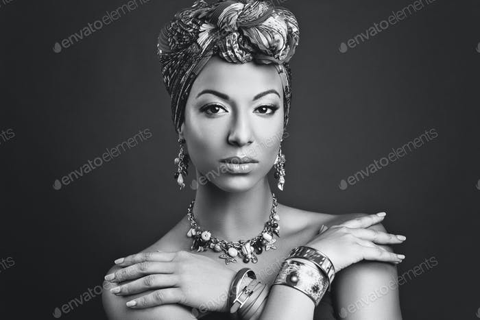 beautiful mulatto young woman with turban on head